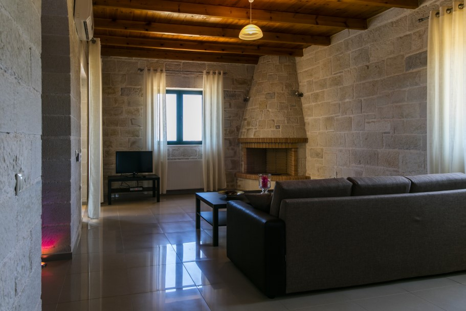 Stone-villa-for-sale-in-Chania-Crete-sitting-room-with-fireplace-bf53af3d
